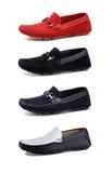 De toevallige schoenen van mensen op wit. Royalty-vrije Stock Afbeelding