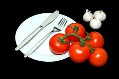 De Tomaat en het knoflook van de Vork van Knfe Stock Afbeelding