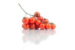 De tomaat van de kers die op wit wordt geïsoleerdc Royalty-vrije Stock Afbeeldingen