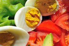 De tomaat van het ei en saladeblad Royalty-vrije Stock Foto's