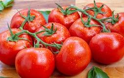 De tomaten met water laat vallen 4 Royalty-vrije Stock Afbeeldingen
