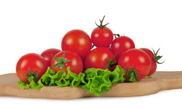 De tomaten van de kers op een scherpe raad Royalty-vrije Stock Foto's