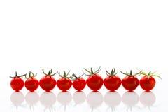 De tomaten van de kers op wit Stock Foto