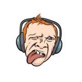 De tong van het grimasgezicht uit met hoofdtelefoons Stock Foto