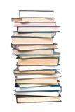De toren van boeken die op wit wordt geïsoleerdg Stock Afbeelding
