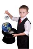 De Tovenaar van het kind met planeten stock foto's