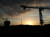 ` De trabalho do ` até o ` do por do sol Fotografia de Stock Royalty Free