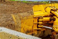 De tractor of de Bulldozer op bouwwerf Stock Fotografie