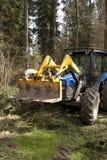 De tractor van de houtvester stock afbeeldingen