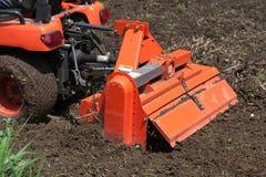 De Tractor van het nut met Uitloper Stock Foto's