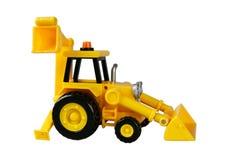 De tractorspeelgoed van Profil met lepel Stock Foto