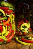 De traditionele gele, groene, rode, hete peper van Jarred Stock Foto's