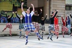 De traditionele Schotse Tatoegering van Edinburgh van dansers Stock Foto's