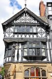 De bouw van Tudor in Straat Eastgate. Chester. Engeland stock afbeelding