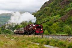 De trein van de stoom in Snowdonia, Wales Stock Foto