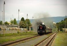 De trein van de stoommotor Stock Afbeeldingen