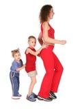 De TREIN van de vrouw met kinderen Stock Afbeeldingen