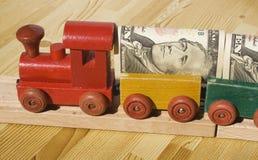 De trein van het Geld Stock Afbeeldingen