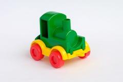 De trein van het stuk speelgoed die op de witte achtergrond wordt geïsoleerd? stock afbeelding