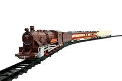 De trein van het stuk speelgoed die op wit wordt geïsoleerdu Stock Afbeelding