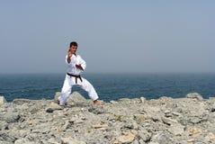 De treinen van de karate op de kusten Royalty-vrije Stock Foto's