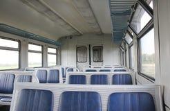 De treinen van de wagen binnen Stock Afbeelding