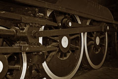 De treinwielen van de stoom Stock Foto's