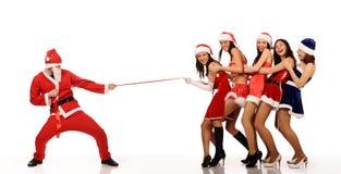 De trekkracht van de Kerstman vijf vrouwen stock foto