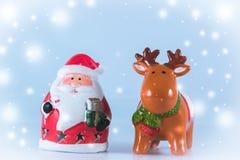 De tribune van de Kerstman en van het rendier op witte achtergrond Stock Afbeeldingen