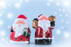 2 de tribune van de Kerstman op witte achtergrond Stock Afbeeldingen