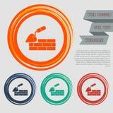 De troffelbouw en bakstenen muurpictogram op de rode, blauwe, groene, oranje knopen voor uw website en ontwerp met ruimteteksten Stock Foto's