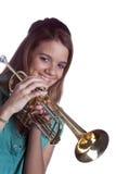 De Trompet van de Holding van de tiener die op Wit wordt geïsoleerde Royalty-vrije Stock Foto's