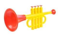 De trompet van kinderen die van gekleurd plastiek wordt gemaakt Stock Foto's