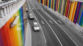 De tunnel van de regenboogauto in Lissabon Stock Foto