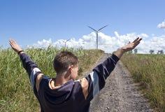 De turbine van de jongen en van de wind Stock Fotografie