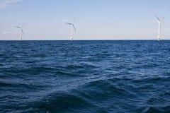 De turbines van de wind op een overzees Stock Fotografie