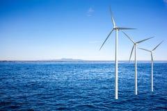 De turbines van windgenerators in overzees stock foto's