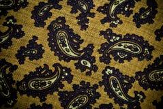 De Turkse of Indische materiële achtergrond of de textuur van Paisley stock afbeelding