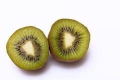 De twee helften van het kiwifruit Stock Afbeelding