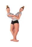 De tweeling tribunes van sportmeisjes Stock Afbeeldingen