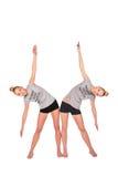 De tweeling zijkromming van sportmeisjes Stock Afbeeldingen