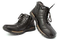 De tweepersoons laarzen van het de winterleer van donker bruine kleur op een wit Royalty-vrije Stock Foto's