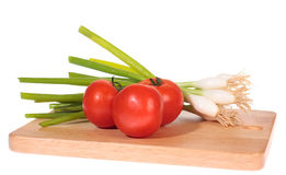 De uien van de lente met tomaten Royalty-vrije Stock Fotografie
