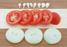 De uien van de tomaat van het knoflook Stock Foto's