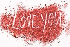 De uitdrukking 'Liefde u 'geschreven op schittert achtergrond royalty-vrije stock afbeeldingen