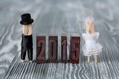 De uitnodiging van het huwelijk 2015 wasknijpers abstracte familie Stock Foto