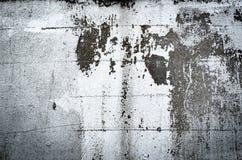 De uitstekende achtergrond van de pleister gele geschilderde muur Stock Foto's
