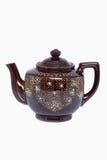 De uitstekende ceramische die theepot op witte achtergrond wordt geïsoleerd Stock Foto