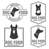 De uitstekende hondevoerkentekens en logotypes plaatsen Stock Foto's