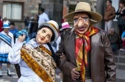 De uitvoerders in de Meidag paraderen in Cusco, Peru stock afbeelding